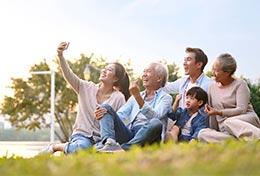 happy family taking a selfie in park